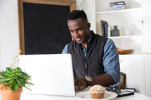 African American man working at a laptop computer