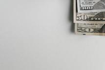 The corners of dollar bills.
