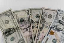 Different denominations of dollar bills.