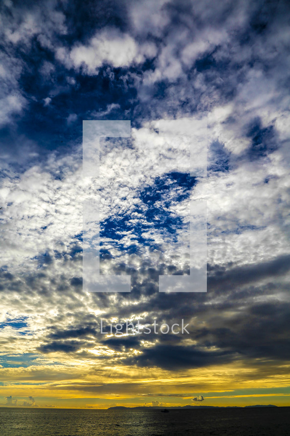 clouds and blue sky over the ocean