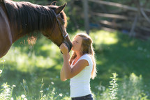 woman kissing a horse