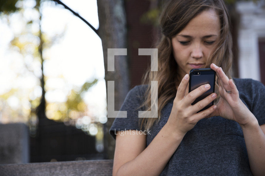 young woman checking her cellphone