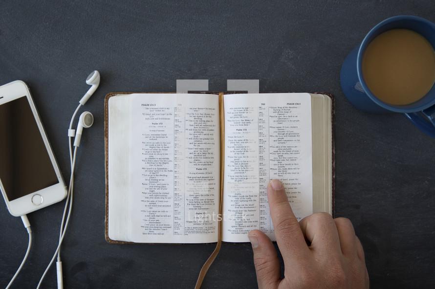 ipod, earbuds, open Bible, reading, podcast, coffee, coffee mug