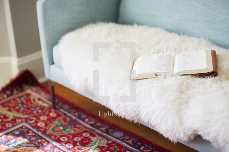 open Bible on a couch