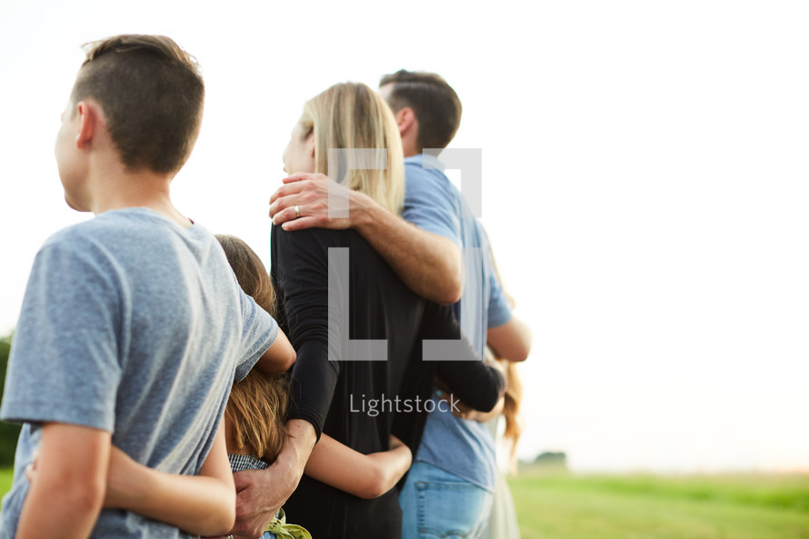 a family arm in arm