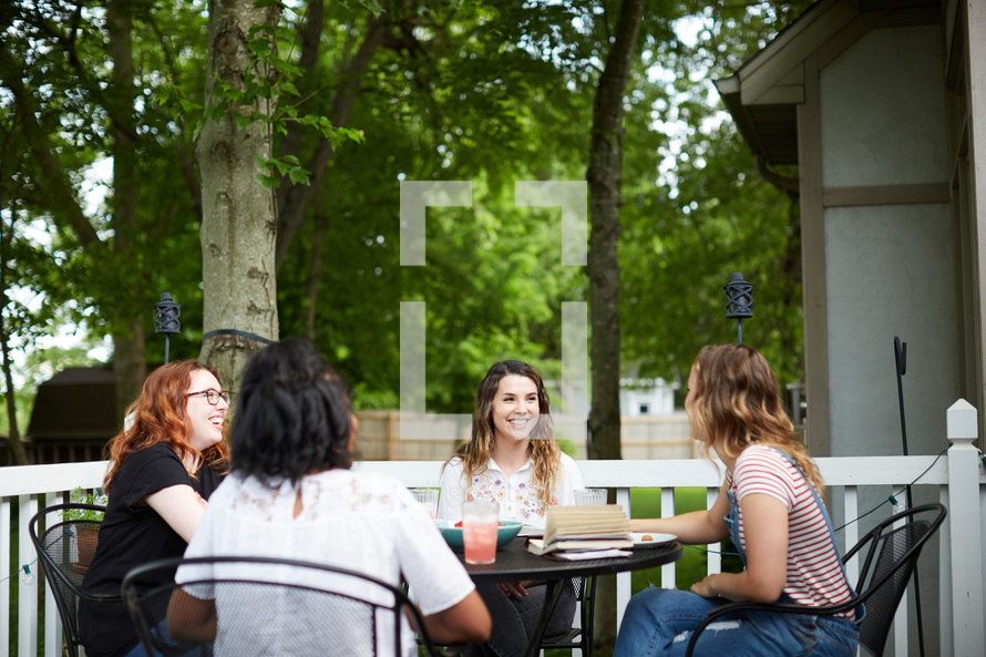 women's group Bible study around an outdoor table