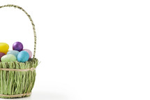 Easter eggs in a basket made with grass.