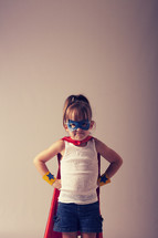 Girl in a superhero costume.