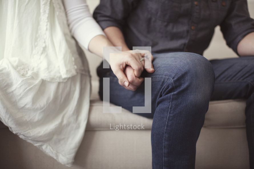 Closeup of couple's hands while making up after an argument.