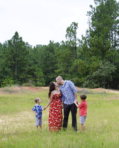 Family standing in a field.