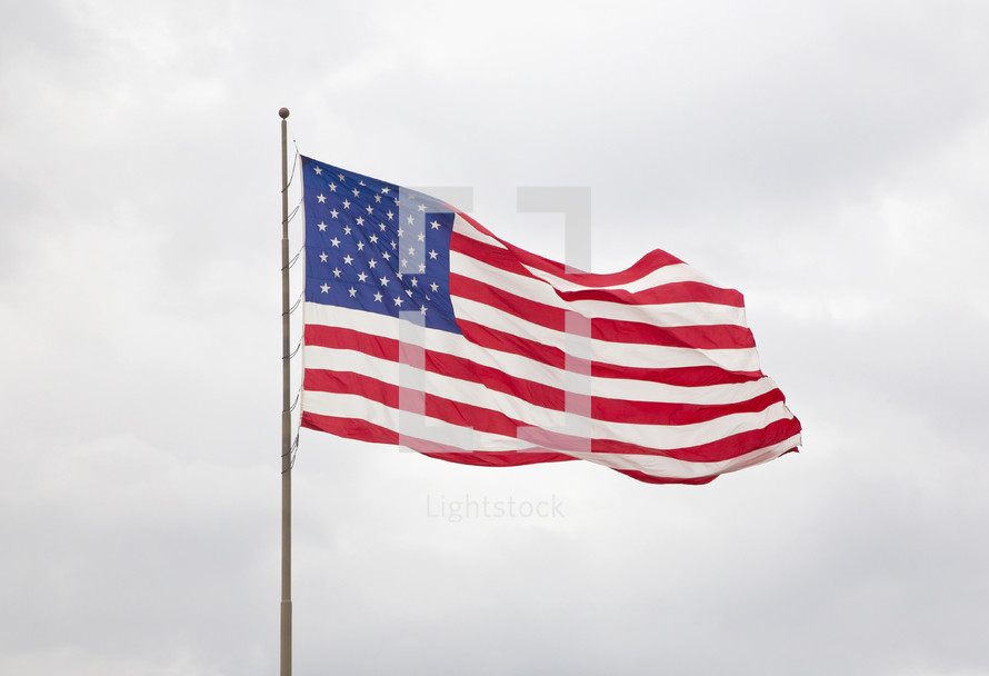 American Flag with a  Cloudy Sky