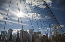 Web of wire cables suspending a bridge.