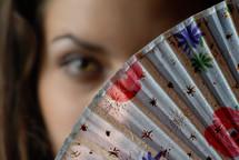 woman behind a fan