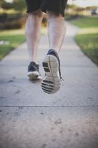 Runner on the sidewalk.