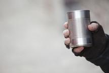 beggar with a tin can