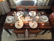 View from above of a dining table set to serve six.
