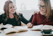 women at a fall Bible study praying