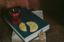 Communion elements on a Bible