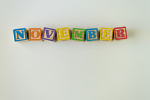 word November in wooden blocks