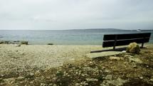 park bench facing the sea