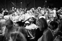 A congregation of people at a church service.