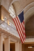 patterned tile on a ceiling and American flag