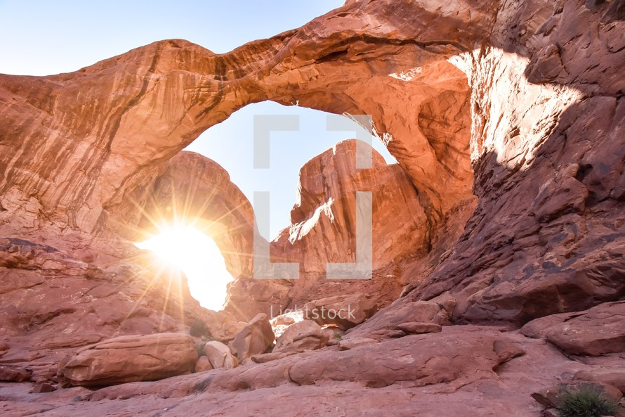 sunburst with an arch in red rocks