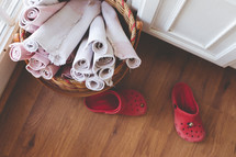 rugs, towels, basket, dirty shoes, mudroom
