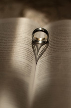 Wedding bands between the pages of a Bible.