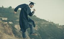 graduate running man pose