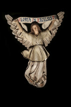 Angel figurine holding a banner reading Gloria in Excelsis