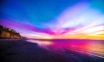 purple glow at sunset over a beach