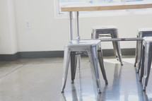metal stools under a table