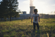 boy and a nuclear power plant