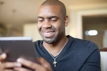 African-American man looking at an iPad screen
