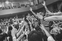 raised hands in worship at a worship service