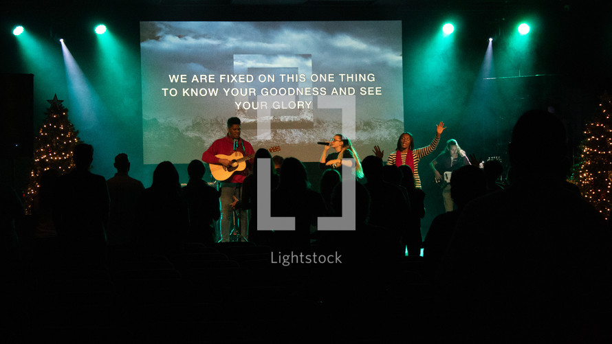 worship leaders on stage at Christmas