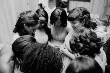 bridesmaids in a prayer circle