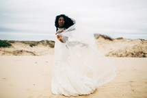 African American bride standing on a beach
