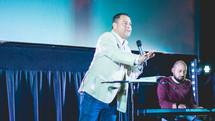 worship leaders speaking on stage