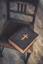 a Bible on a chiar