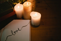 The word love and candles