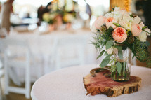 Bouquet of roses in vase as a centerpiece on a table.