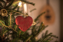 heart shaped ornament on a Christmas tree