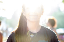 sun glare on a teen girls face