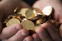 hands full of dollar coins