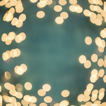 border of white bokeh lights.
