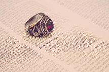 high school ring on the pages of a Bible