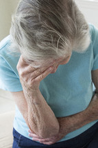 grieving elderly woman