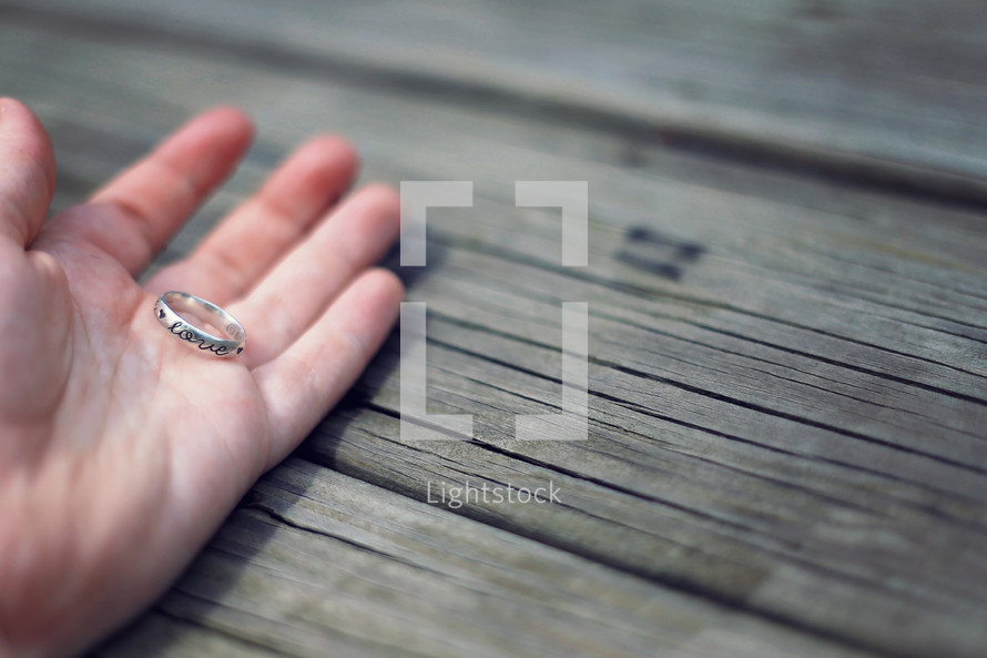 wedding band in a hand